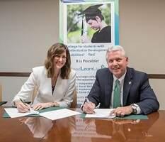 President Turner signing documents to begin RiverHawks Scholar Program