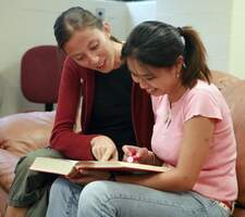 2 students viewing a book
