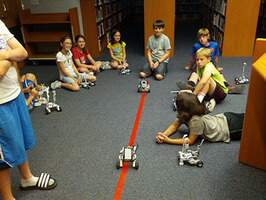Children playing with robotics vehicles